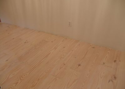SATIN/MATTE SKID SAFE on light colored wood floor